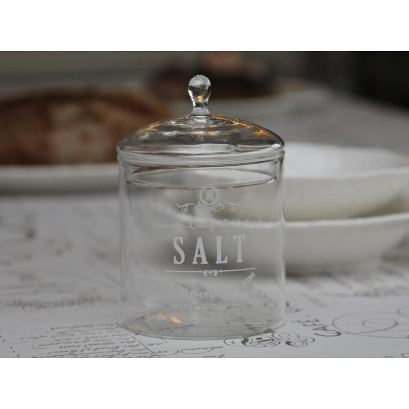 Saltkrukke med låg i glas.